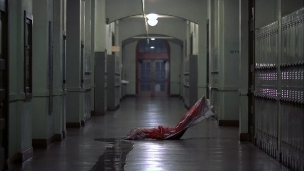 A Bloodied Teenaged Girl, Wrapped in Plastic.